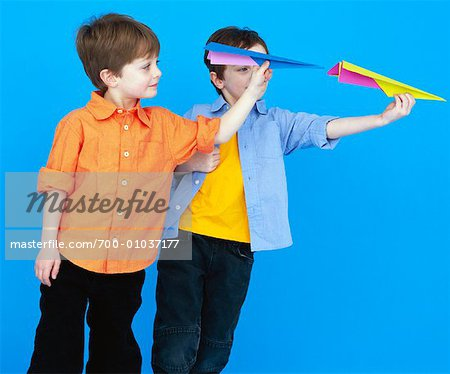 Boys Throwing Paper Airplanes Stock Photo - Rights-Managed, Image code: 700-01037177