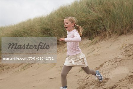 Girl Running Down Sand Dune