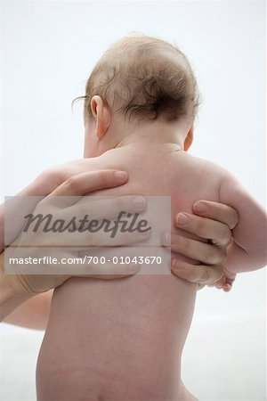Person Holding Baby Stock Photo - Rights-Managed, Image code: 700-01043670