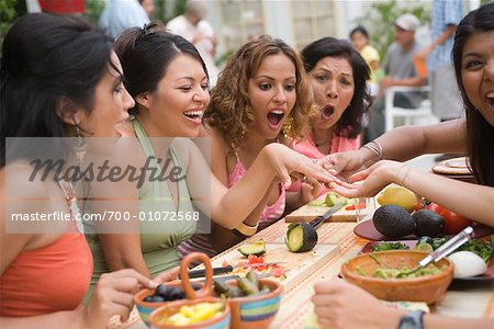 Woman Showing Engagement Ring to Friends at Party Stock Photo - Rights-Managed, Image code: 700-01072568