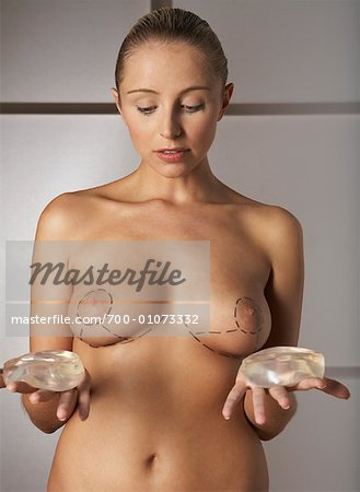 Portrait of Woman Holding Breast Implants Stock Photo - Rights-Managed, Image code: 700-01073332
