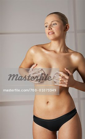 Woman Holding Breast Implants Stock Photo - Rights-Managed, Image code: 700-01073349