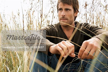 Portrait of Man Sitting in Long Grass Stock Photo - Rights-Managed, Image code: 700-01082837