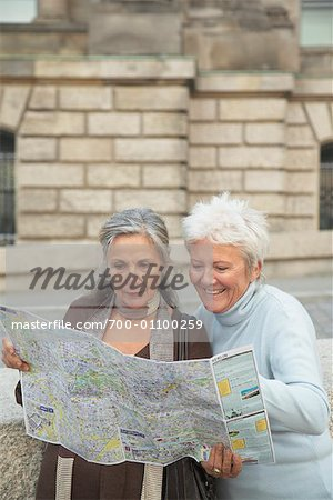 Tourists Looking at Map Stock Photo - Rights-Managed, Image code: 700-01100259