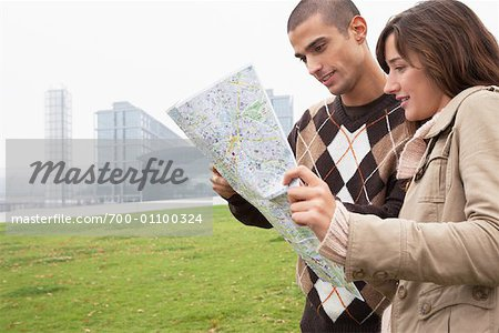 Couple Looking at Map Stock Photo - Rights-Managed, Image code: 700-01100324