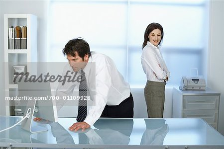 Business Woman Looking at Business Man Stock Photo - Rights-Managed, Image code: 700-01109928
