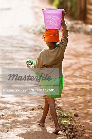 Girl Carrying Water, Ambalavao, Madagascar Stock Photo - Rights-Managed, Image code: 700-01112681