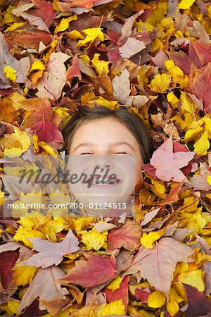 Girl Lying in Leaves Stock Photo - Rights-Managed, Image code: 700-01124513