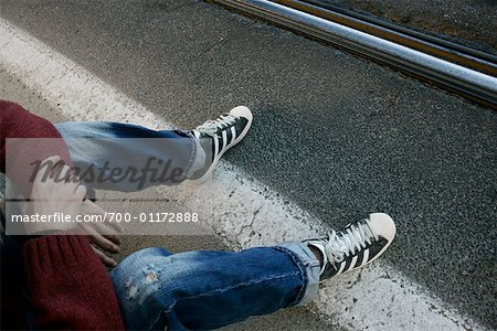 Man Sitting on Road Stock Photo - Rights-Managed, Image code: 700-01172888