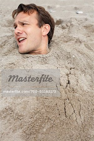 Man Buried in Sand at Beach