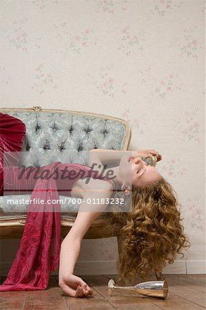 Woman Sleeping on Sofa Stock Photo - Rights-Managed, Image code: 700-01183232
