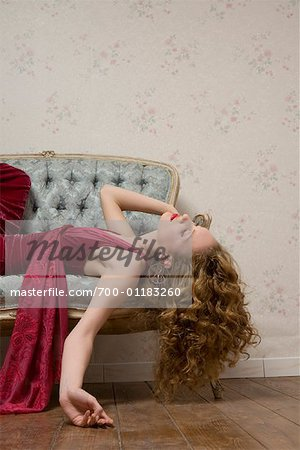Woman Lying on Sofa Stock Photo - Rights-Managed, Image code: 700-01183260