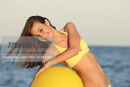 Girl at Beach with Exercise Ball Stock Photo - Rights-Managed, Image code: 700-01183756
