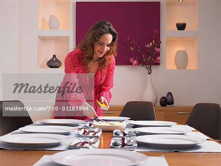 Woman Setting Table for Dinner Party Stock Photo - Rights-Managed, Image code: 700-01183894