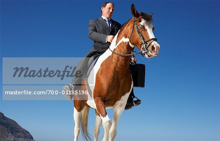 Businessman Riding Horse Stock Photo - Rights-Managed, Image code: 700-01185196
