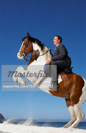 Horse Rearing with Businessman on Its Back Stock Photo - Rights-Managed, Image code: 700-01185197