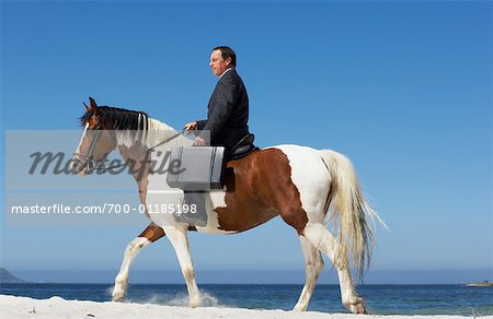 Businessman Riding Horse to Work Stock Photo - Rights-Managed, Image code: 700-01185198