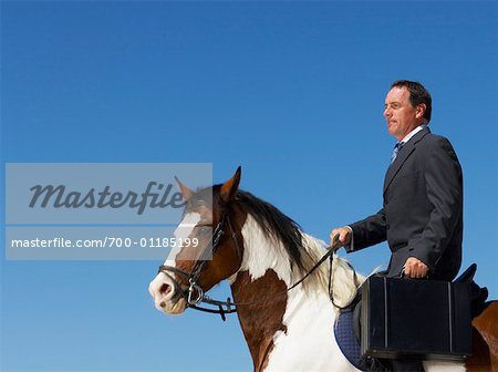 Businessman Riding Horse to Work Stock Photo - Rights-Managed, Image code: 700-01185199
