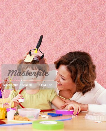 Mother and Daughter Making Crafts