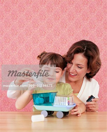 Mother and Daughter Making Crafts Stock Photo - Rights-Managed, Image code: 700-01194573