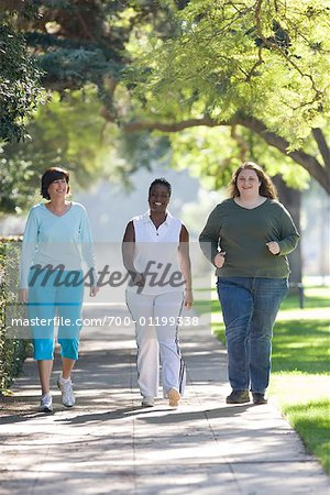 Three Women Walking Stock Photo - Rights-Managed, Image code: 700-01199338