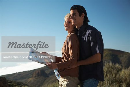 Couple Hiking, Looking at Map Stock Photo - Rights-Managed, Image code: 700-01199895