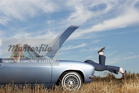 Woman Looking Under Hood of Stalled Car Stock Photo - Rights-Managed, Image code: 700-01199947