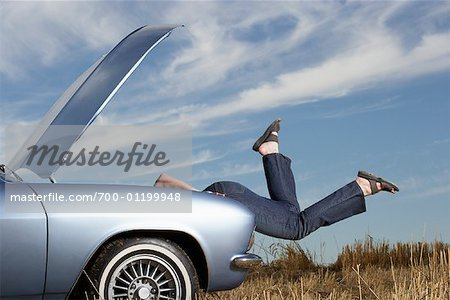 Woman Looking Under Hood of Stalled Car Stock Photo - Rights-Managed, Image code: 700-01199948