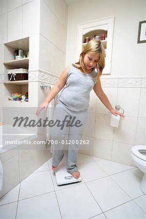Girl Using Scale Stock Photo - Rights-Managed, Image code: 700-01200262