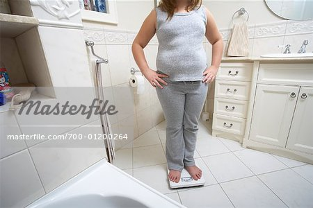 Girl Standing on Scale Stock Photo - Rights-Managed, Image code: 700-01200264