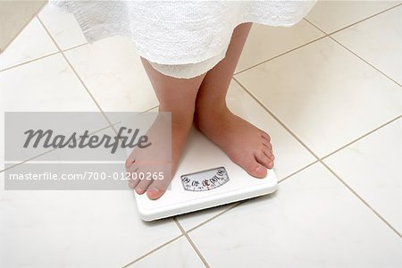 Girl Standing on Scale Stock Photo - Rights-Managed, Image code: 700-01200265