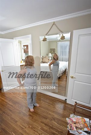 Girl Looking in Mirror Stock Photo - Rights-Managed, Image code: 700-01200266