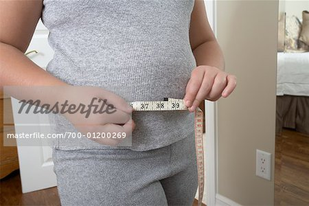 Girl Measuring Waist Stock Photo - Rights-Managed, Image code: 700-01200269