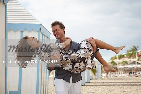 Man Carrying Woman at Beach Stock Photo - Rights-Managed, Image code: 700-01200435