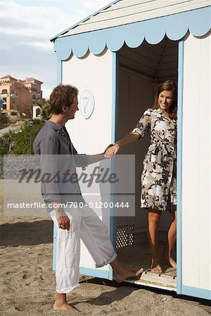 Woman Leading Man into Change Room Stock Photo - Rights-Managed, Image code: 700-01200444