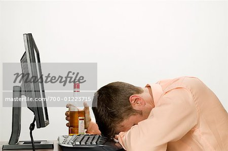 Businessman Passed out at Computer after Drinking Stock Photo - Rights-Managed, Image code: 700-01223715