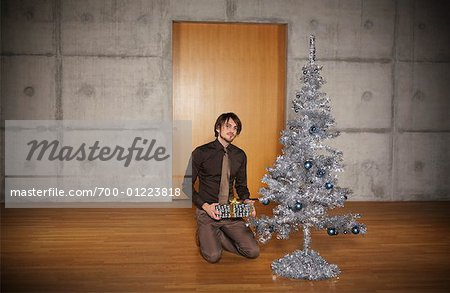 Portrait of Man with Christmas Tree Stock Photo - Rights-Managed, Image code: 700-01223818