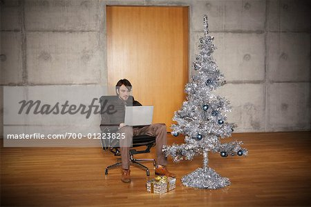 Portrait of Man with Christmas Tree Stock Photo - Rights-Managed, Image code: 700-01223825