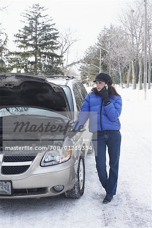 Woman Using Cellular Phone by Car Stock Photo - Rights-Managed, Image code: 700-01235334