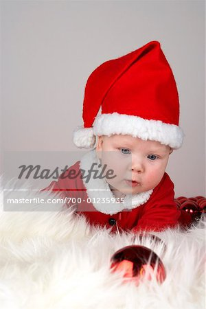 Portrait of Baby Wearing Santa Costume