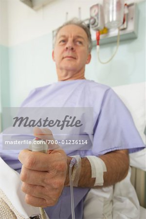 Man in Hospital Bed Stock Photo - Rights-Managed, Image code: 700-01236114