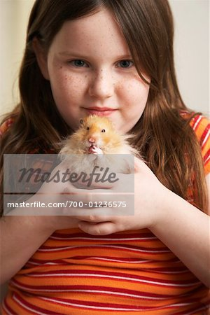 Portrait of Girl Holding Hamster Stock Photo - Rights-Managed, Image code: 700-01236575