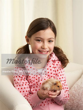 Portrait of Girl with Hamster Stock Photo - Rights-Managed, Image code: 700-01236586