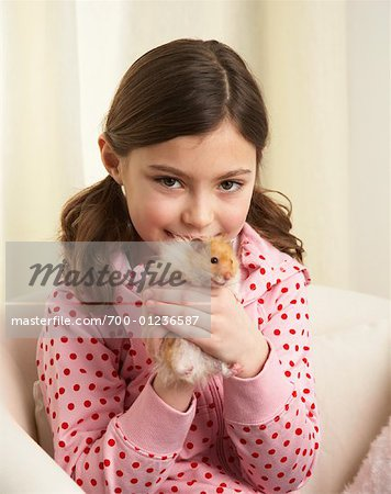 Portrait of Girl with Hamster Stock Photo - Rights-Managed, Image code: 700-01236587