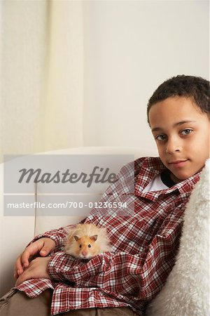 Boy Holding Hamster Stock Photo - Rights-Managed, Image code: 700-01236594