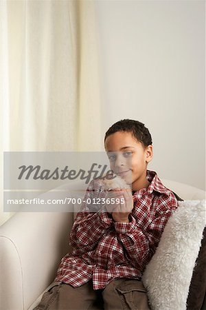 Boy Holding Hamster Stock Photo - Rights-Managed, Image code: 700-01236595