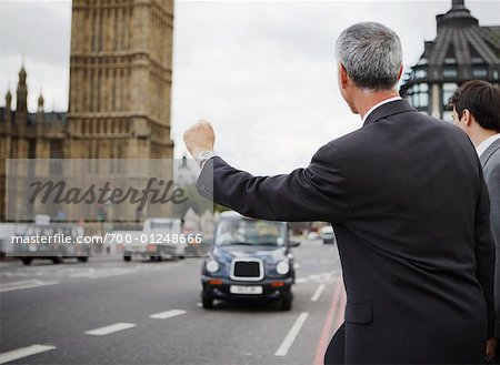 Businessman Hailing Taxi, London, England Stock Photo - Rights-Managed, Image code: 700-01248666