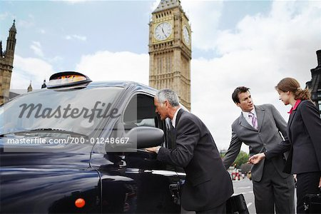 Businesspeople Getting in Taxi, London, England Stock Photo - Rights-Managed, Image code: 700-01248667