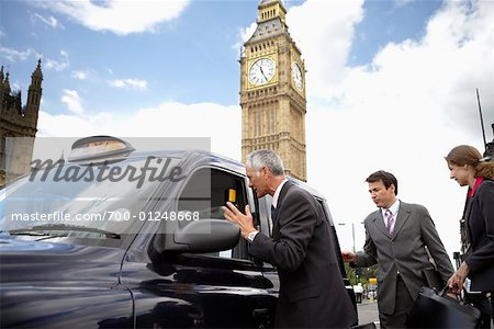 Businesspeople Getting in Taxi, London, England Stock Photo - Rights-Managed, Image code: 700-01248668
