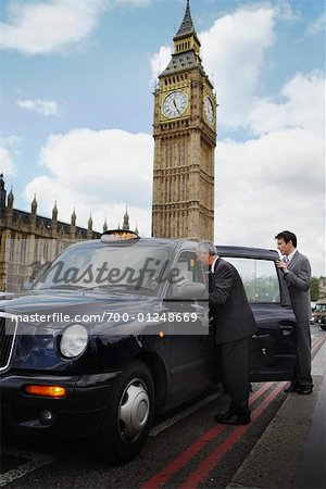 Businesspeople Getting in Taxi, London, England Stock Photo - Rights-Managed, Image code: 700-01248669